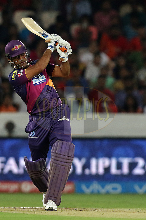 Rising Pune Supergiants captain MS Dhoni plays a shot during match 22 of the Vivo IPL 2016 (Indian Premier League ) between the Sunrisers Hyderabad and the Rising Pune Supergiants held at the Rajiv Gandhi Intl. Cricket Stadium, Hyderabad on the 26th April 2016<br /> <br /> Photo by Rahul Gulati / IPL/ SPORTZPICS