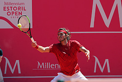 May 4, 2018 - Estoril, Portugal - Stefanos Tsitsipas of Greece returns a ball to Roberto Carballes Baena of Spain during the Millennium Estoril Open ATP 250 tennis tournament quarterfinals, at the Clube de Tenis do Estoril in Estoril, Portugal on May 4, 2018. (Credit Image: © Pedro Fiuza via ZUMA Wire)