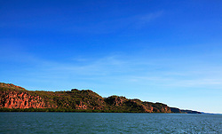 Red cliffs and mangroves line the mouth of the Hunter River.
