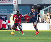8th May 2018, Global Energy Stadium, Dingwall, Scotland; Scottish Premiership football, Ross County versus Dundee; Glen Kamara of Dundee holds off Alex Schalk of Ross County
