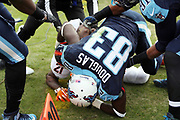 Players and officials converge on the scene as Denver Broncos cornerback Aqib Talib (21) grapples with Tennessee Titans wide receiver Harry Douglas (83) in the second quarter during the 2016 NFL week 14 regular season football game against the Tennessee Titans on Sunday, Dec. 11, 2016 in Nashville, Tenn. The Titans won the game 13-10. (©Paul Anthony Spinelli)