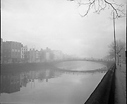 Halfpenny Bridge in the mist taken from Wellington Quay Dublin city 2 way traffic with bus stop near Templebar .10/01/1970