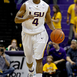 December 29, 2011; Baton Rouge, LA; LSU Tigers guard Chris Bass (4) against the Grambling State Tigers during the second half of a game at the Pete Maravich Assembly Center.  LSU defeated Grambling State 69-37. Mandatory Credit: Derick E. Hingle-US PRESSWIRE