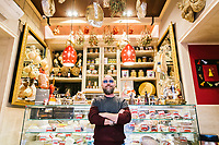 NAPLES, ITALY - 4 JANUARY 2019: Francesco Andoli, founder and owner of Janarius, a restaurant in Naples, poses for a portrait in front of the cold-cut counter of the restaurant in Naples, Italy, on January 4th 2019.<br /> <br /> Janarius is a typical Neapolitan gourmet restaurant and shop founded by Francesco Andoli in September 2018 in via Duomo, in front of the Naples's Duomo and treasure of Saint Janarius.