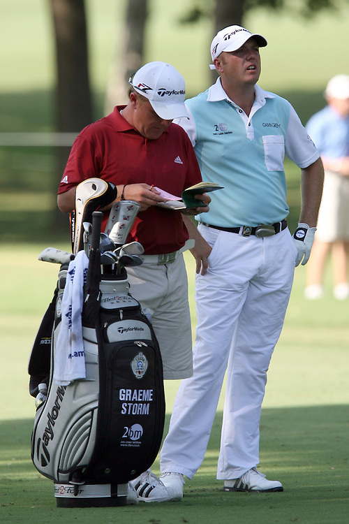 09 August 2007: Graeme Storm and caddie Dom Bott survey the next shot on the 9th hole during the first round of the 89th PGA Championship at Southern Hills Country Club in Tulsa, OK.