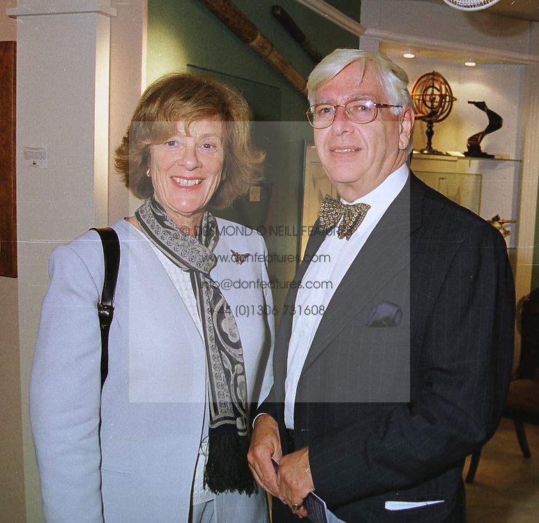 MR & MRS STEPHEN RUBIN, parents of Amanda, Lady Harlech, at an antiques fair in London on 9th June 1999.MSY 67