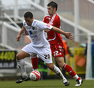 Swindon - Saturday March 20th, 2010: Darel Russell of Norwich and Charlie Austin of Swindon in action during the Coca Cola League One match at The County Ground, Swindon. (Pic by Paul Chesterton/Focus Images)