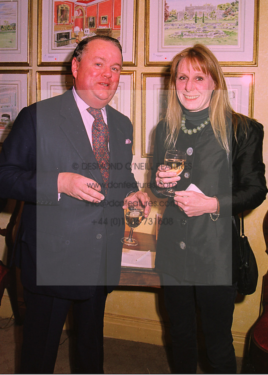 LORD MICHAEL PRATT and MRS JAMES GUTHRIE wife of the QC. at a party in London on 7th May 1998.MHK 3