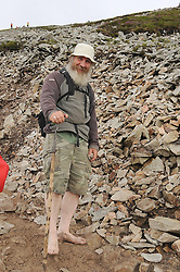 Barefooted pilgrim Johnny Toner from Kinlough Leitrim on the annual pilgrimage to Croagh Patrick yesterday. <br /> Pic Conor McKeown