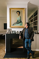 """ROME, ITALY - 21 FEBRUARY 2020:  Italian novelist and essayist Sandro Veronesi (60) poses for a portrait as he looks at a painted portrait of his wife's great aunt in his home in Rome, Italy, on February 21st 2020.<br /> <br /> In 2006 Sandro Veronesi won the Strega Prize, the most prestigious Italian literary award, with his book """"Caos Calmo"""". His latest novel is """"Il Colibrì"""" (2019)."""