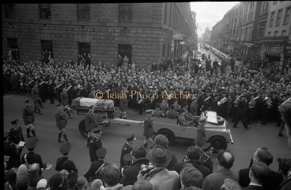 The remains of Roger Casement, Irish Patriot, were removed from the Military Church, Arbour Hill, where they lay in state for 4 days, to the Pro-Cathedral..Picture shows the scene outside the G.P.O., Headquarters of the 1916 Rising, as the coffin passes the crowd..18.02.1965
