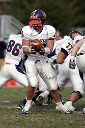 10 November 2007: Kyle Bradley takes the snap and looks for a running back. This game between the Wheaton College Thunder and the Illinois Wesleyan University Titans was for a share of the CCIW Championship and was played at Wilder Field on the campus of Illinois Wesleyan University in Bloomington Illinois.