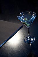 Still life of Martini drink and restaurant menu.