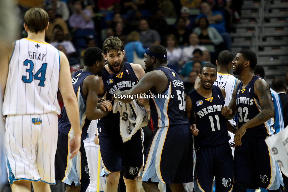 April 1, 2011; New Orleans, LA, USA; Memphis Grizzlies center Marc Gasol (center) celebrates with teammates power forward Darrell Arthur (left) and power forward Zach Randolph (right) after making a buzzer beating shot at the end of the first half against the New Orleans Hornets at the New Orleans Arena.    Mandatory Credit: Derick E. Hingle