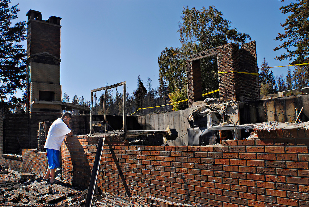 Amanda Price looks over the remains of her Gellatly Road South home on July 22, 2009. The home was destroyed in the Glenrosa forest  fire.
