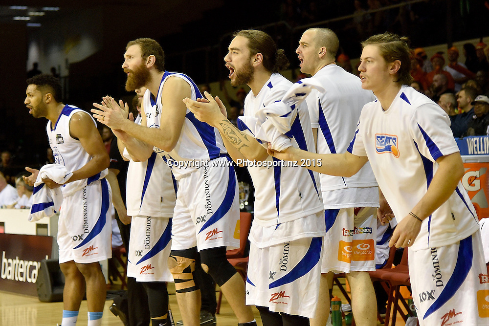 The Saints celebrate  a three pointer during the NBL final basketball match between Wellington Saints and Southland Sharks at the TSB Arena in Wellington on Sunday the 5th of July 2015. Copyright photo by Marty Melville / www.Photosport.nz