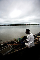 A man sits in his canoe in the Atrato River in Quibdo, the capital of the state of Choco, on October 10, 2006. Choco is a state that has suffered terribly at the hands of both rightwing paramilitaries and leftist rebels over the years, causing many to flee to other parts of Colombia. The Choco is located on the Pacific coast of Colombia. (Photo/Scott Dalton)