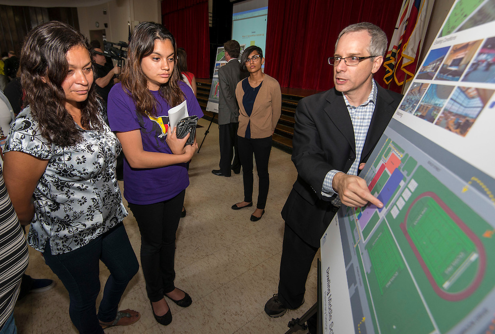 Houston ISD staff and Harrison Kornberg architects give a project update during a Bond community meeting at Dowling Middle School, June 17, 2014.