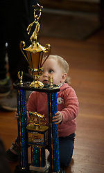 An unidentified child marvels at a trophy handed out to his parents during the 19th annual Spam Festival, Sunday, Feb. 19, 2017, in Isleton, Calif. (Photo by D. Ross Cameron)