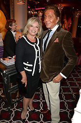 VALENTINO and ELAINE PAIGE at a party to celebrate the publication of 'Passion for Life' by Joan Collins held at No41 The Westbury Hotel, Mayfair, London on21st October 2013.