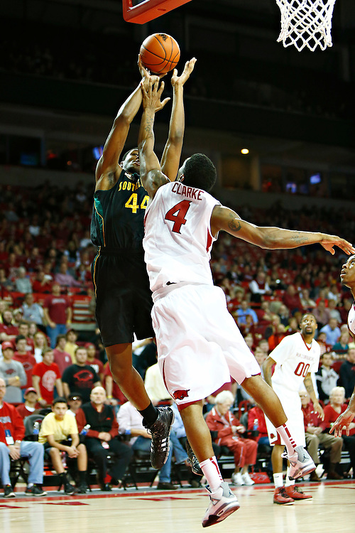 FAYETTEVILLE, AR - DECEMBER 3:  Forrest Johnson #44 of the SE Louisiana Lions shoots a jumps shot over Coty Clarke #4 of the Arkansas Razorbacks at Bud Walton Arena on December 3, 2013 in Fayetteville, Arkansas.  (Photo by Wesley Hitt/Getty Images) *** Local Caption *** Forrest Johnson; Coty Clarke