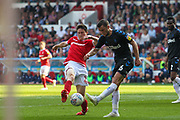 Joe Lolley (23) tackles Jonathan Howson (16) during the EFL Sky Bet Championship match between Nottingham Forest and Middlesbrough at the City Ground, Nottingham, England on 22 April 2019.