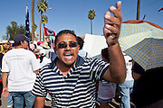 Apr. 19, 2009 -- PHOENIX, AZ: A man chants and cheers during a United Farm Workers of America march in central Phoenix Sunday. About 2,000 people marched from the Arizona State Capitol to Cesar Chavez Plaza in downtown Phoenix. The march was organized by the United Farm Workers of America to promote immigration reform.  Photo by Jack Kurtz