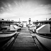 Dory Fishing Fleet historic landmark in Newport Beach on Balboa Peninsula in Orange County Southern Calfornia. High resolution photo is black and white.