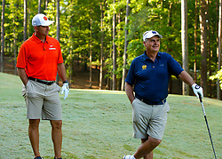 Clemson  head football coach Dabo Swinney speaks with Notre Dame alumnus Jimmy Dunne during the Chick-fil-A Peach Bowl Challenge at the Ritz Carlton Reynolds, Lake Oconee, on Monday, April 30, 2019, in Greensboro, GA. (Paul Abell via Abell Images for Chick-fil-A Peach Bowl Challenge)