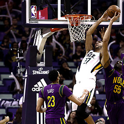Feb 8, 2017; New Orleans, LA, USA; Utah Jazz center Rudy Gobert (27) shoots over New Orleans Pelicans guard E'Twaun Moore (55) and guard Jrue Holiday (11) and forward Anthony Davis (23) during the first quarter of a game at the Smoothie King Center. Mandatory Credit: Derick E. Hingle-USA TODAY Sports