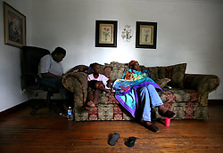 09 July 2006. New Orleans. Louisiana. <br /> Finding Faith. <br /> Faith Figueroa. A day in the life of. On a rainy Sunday afternoon Faith curls up on the sofa to watch TV with her sisters Anferyna and Jacquelyn as their mother Miriam scans the local paper for employment opportunities. <br /> Following a ten month search for the little girl whose face appeared on the Sept 19th, 2005 cover of Newsweek magazine, Faith's mother, Miriam Figueroa has returned to town with her three children. Faith, (1 yrs), Anfernya (5yrs) and Jacquelyn (13 yrs). <br /> Credit; Charlie Varley/varleypix.com