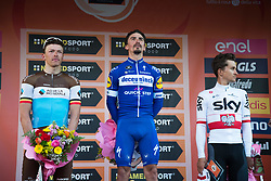 March 24, 2019 - Sanremo, Sanremo, Italy - Julian Alaphilippe (C) of the Deceuninck team, winner with Oliver Naesen of AG2R La Mondiale (L) second and Michal Kwiatkowski of Team Sky, third (R) are seen on the podium during the 110th edition of Milan - Sanremo, cycling race. (Credit Image: © Puletto  Diego/SOPA Images via ZUMA Wire)