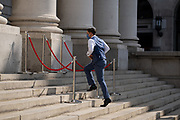 A waiter runs up the steps of Royal Exchange where Fortnum & Mason have set up an outdoor restaurant and bar opposite the Bank of England in the City of London, during the Coronavirus pandemic, on 9th September 2020, in London, England.on 16th September 2020, in London, England.