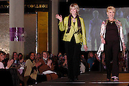 Wearing fashions from The Secret Ingredient, models Brenda Dixon (left) and Cathy Bohanon on the runway during A'Wear Affair, the Noble Circle fundraising fashion show, at Sinclair College's David H. Ponitz Center, Saturday, February 23, 2013.  Dixon has been thriving beyond colorectal cancer since 2009 and lung cancer since 2012.  Bohanon has been thriving beyond breast cancer since April 2010.