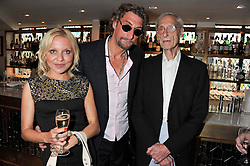 Left to right, SIMONE NICA, NICK REYNOLDS and Great Train robber & writer BRUCE REYNOLDS at a party to celebrate the publication on The House of Rumour by Jake Arnott held at The Ivy Club, West Street, London on 9th July 2012.