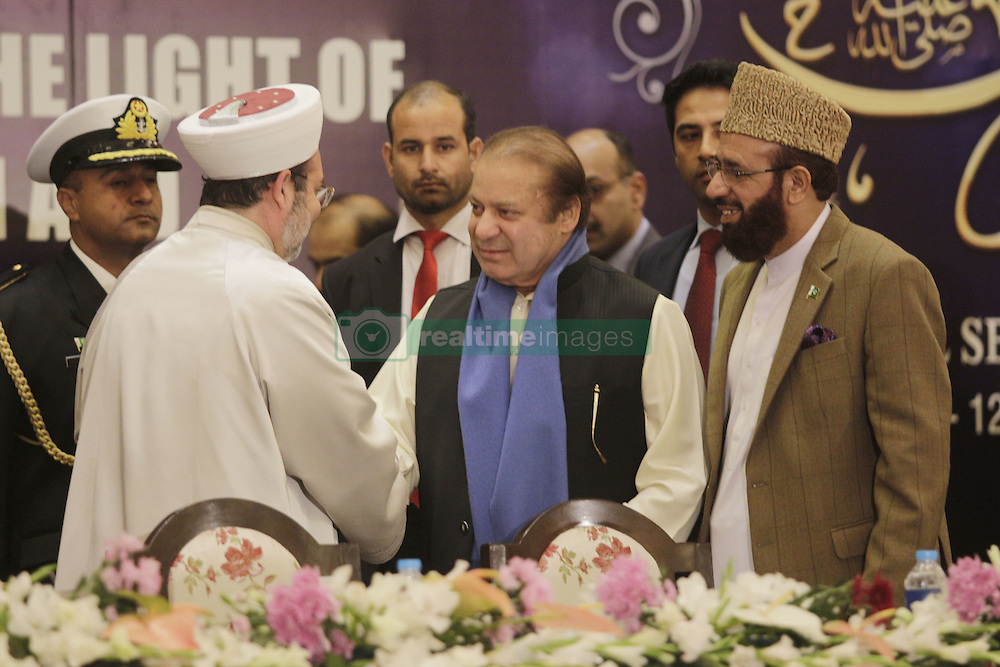 December 12, 2016 - Lahore, Punjab, Pakistan - Prime Minister Pakistan Mian Muhammad Nawaz Sharif shake hands with Turkish Head of the Religious Affairs Directorate, Mehmet Gormez  during Seerat Conference, a special prayer organized within the celebration for Mawlid al-Nabi, birth anniversary of Muslims' beloved Prophet Mohammad in Lahore. (Credit Image: © Rana Sajid Hussain/Pacific Press via ZUMA Wire)