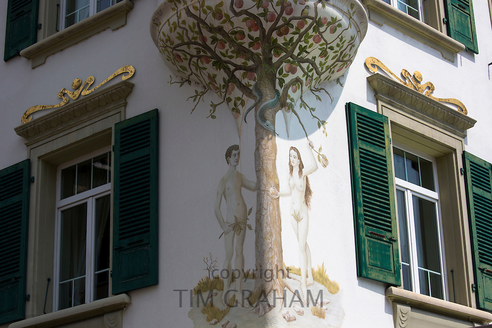 Mural of Adam and Eve in garden of Eden religious scene in Marktplatz  at Interlaken, Bernese Oberland, Switzerland