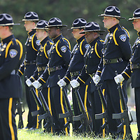 The Oxford Police Department Honor Guard stands ready before they deliver the 21 gun salute for former Lafayette County Sheriff Buddy east Friday afternoon.