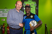Forest Green Rovers Drissa Traoré(4) with the Matchball sponsor during the Vanarama National League Play Off second leg match between Forest Green Rovers and Dagenham and Redbridge at the New Lawn, Forest Green, United Kingdom on 7 May 2017. Photo by Shane Healey.