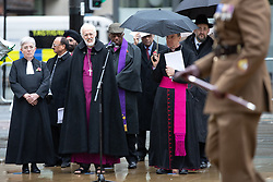 © Licensed to London News Pictures . 11/11/2018. Manchester , UK . The Archbishop of Manchester DAVID WALKER amongst a multi-faith contingent during preparations being made ahead of a service of remembrance for those killed in war to be held at 11am at the Manchester Cenotaph in St Peter's Square , on the 100th anniversary of Armistice Day , marking the end of the First World War . Photo credit : Joel Goodman/LNP