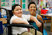 Noah Stout, 7, poses for a portrait with his second grade teacher Hilary Leday at Sinnott Elementary School in Milpitas, California, on August 29, 2013. (Stan Olszewski/SOSKIphoto)