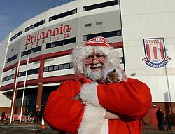A Stoke City supporter poses for a photo outside the Britannia Stadium - Photo mandatory by-line: Dougie Allward/JMP - Mobile: 07966 386802 - 06/12/2014 - SPORT - Football - Stoke - Britannia Stadium - Stoke City v Arsenal - Barclays Premie League