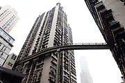 CHONGQING, CHINA - DECEMBER 14: (CHINA OUT) <br /> <br /> Pedestrian Bridge Gets Built At 13th Floor<br /> <br /> A pedestrian bridge gets built at the 13th floor between two buildings on December 14, 2014 in Chongqing, China. A pedestrian bridge was built at the 13th floor between Taiyanggou police station and Xinlong Building for the convenience of local people on Sunday in Chongqing.<br /> ©Exclusivepix Media