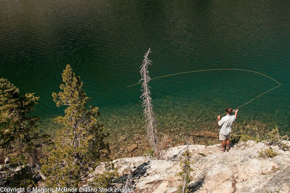 Man fly fishing at Mystery Lake a day hike from the Diamond D Ranch in the Frank Church Wilderness of Idaho.