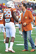 AUSTIN, TX - OCTOBER 18:  Matthew McConaughey speaks with Malcolm Brown #28 of the Texas Longhorns before kickoff against the Iowa State Cyclones on October 18, 2014 at Darrell K Royal-Texas Memorial Stadium in Austin, Texas.  (Photo by Cooper Neill/Getty Images) *** Local Caption *** Malcolm Brown; Matthew McConaughey