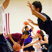 111412       Cable Hoover<br /> <br /> Miyamura Patriots Stone Senoski, right, and Austin Smith square off in defensive drills during basketball practice at Miyamura High School Wednesday.