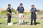 The Milpitas Fire Department inspects and approves the mortar layout safety before the 4th of July celebrations at the Milpitas Sports Center.  Photo by Stan Olszewski/SOSKIphoto.