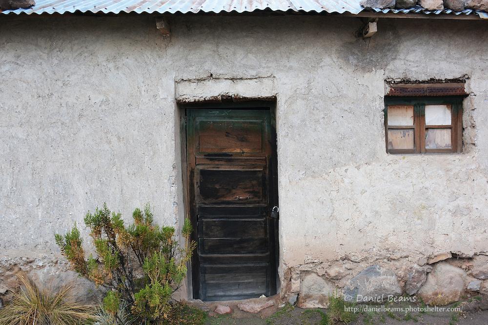Doors and adobe houses in Tomarapi, Sajama National Park, Bolivia