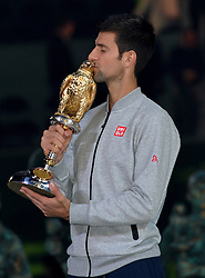 DOHA, Jan. 8, 2017  Novak Djokovic of Serbia kisses the trophy during the awarding ceremony for the men's singles event of the Qatar ATP Open tennis tournament at the Khalifa International Tennis Complex in Doha, capital of Qatar, on Jan. 7, 2017. Novak Djokovic on Saturday beat Andy Murray of Britain 2-1 in the final to claim the title. (Credit Image: © Nikku/Xinhua via ZUMA Wire)