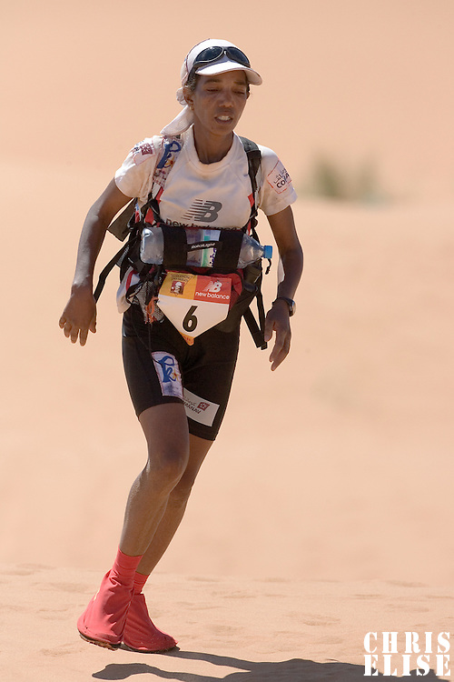 30 March 2007: #6 Touda Didi of Morocco runs over a dune in erg Znaigui en route to check point 3 during fifth stage of the 22nd Marathon des Sables between west of Kfiroun and erg Chebbi (26.22 miles). The Marathon des Sables is a 6 days and 151 miles endurance race with food self sufficiency across the Sahara Desert in Morocco. Each participant must carry his, or her, own backpack containing food, sleeping gear and other material.